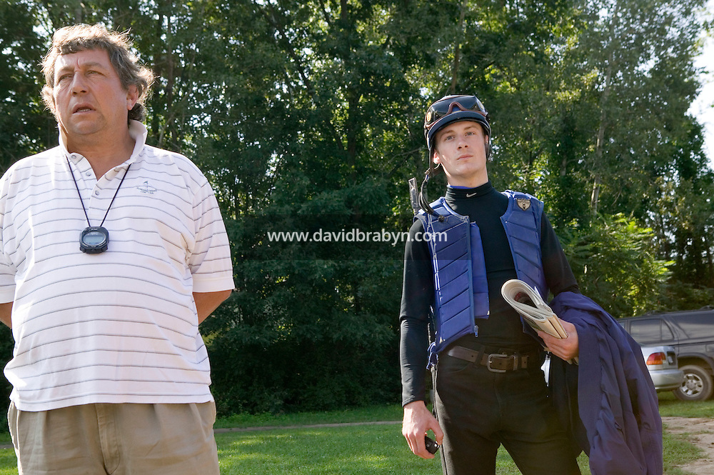 Jockey Julien Leparoux (R) talks about the afternoon racing strategy with trainer Patrick Biancone after the morning practice ride, in Saratoga Springs, NY, United States, 5 August 2006.