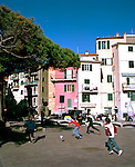 Boys playing soccer in Liguria, Italy