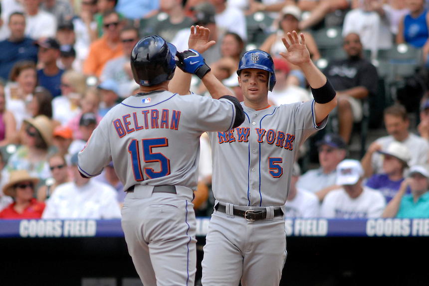 22 June 2008: New York Mets 3rd baseman David Wright congratulates teammate Carlos Beltran after Beltran hit a two-run homerun against the Colorado Rockies. The Mets defeated the Rockies 3-1 at Coors Field in Denver, Colorado on June 22, 2008.