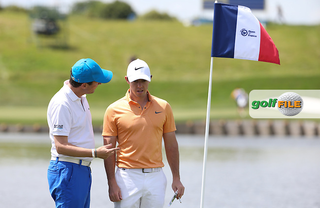 Rory McIlroy (NIR) in deep conversation with an amateur during the Wednesday Pro-Am ahead of the 100th Open de France, played at Le Golf National, Guyancourt, Paris, France. 29/06/2016. Picture: David Lloyd | Golffile.<br /> <br /> All photos usage must carry mandatory copyright credit (&copy; Golffile | David Lloyd)