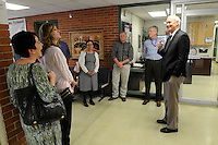 NWA Democrat-Gazette/ J.T. WAMPLER --  Fayetteville Public Schools superintendent talks to school board members and other school officials Monday March 30, 2015 during a tour of the facilities at the Agee-Lierly lIfe Preparation Services Center (ALLPS) campus.