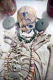 BELIZE, Belize City, a Maya skeleton that was buried with jewelry is on display at the Museum of Belize