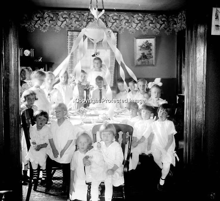 BIRTHDAY PARTY. This image of a children's party appears to have been accomplished with available light.<br />