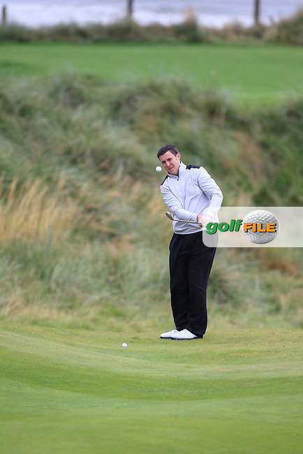 Paul O'Hara (Kilkenny) chipping onto the 3rd green during the South of Ireland Amateur Open Championship Semi-Finals at Lahinch Golf Club  31th July 2013 <br /> Picture:  Thos Caffrey / www.golffile.ie