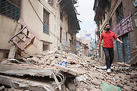 A man walks in a street full with rubble in Shanku near Kathmandu, Nepal.  . May 9, 2015