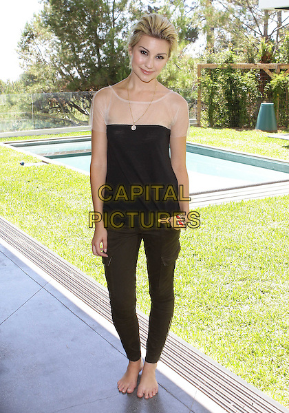 "CHELSEA STAUB .4th Annual ""Eco-Emmys"" Celebrity Chateau Honors  Emmy Nominees held at Fully 'Green"" Private Estate, Los Angeles, California, USA, .26th August 2010..full length top black green khaki trousers pants jeans beige cream sheer see thru through mesh gold necklace pockets  .CAP/ADM/TC.©T. Conrad/AdMedia/Capital Pictures."