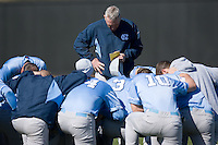 North Carolina Tar Heels head coach Mike Fox leads his team in prayer prior to taking on the St. John's Red Storm at the 2008 Coca-Cola Classic at the Winthrop Ballpark in Rock Hill, SC, Sunday, March 2, 2008.