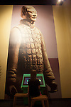 "A child interacting with the multimedia exhibit;  the ""Terra Cotta Warriors: The Emperor's Painted Army,"" Exhibit directly from Xian in the Shaanxi Province, China debuted in 2014 at the Children's Museum, Indianapolis, Indiana, USA"