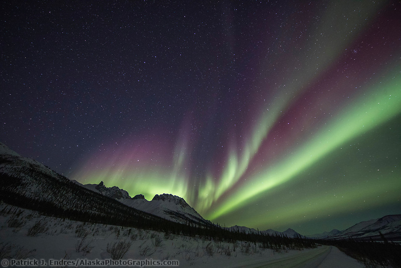 Northern lights over mount Snowden, Brooks Range mountains in Alaska's Arctic.