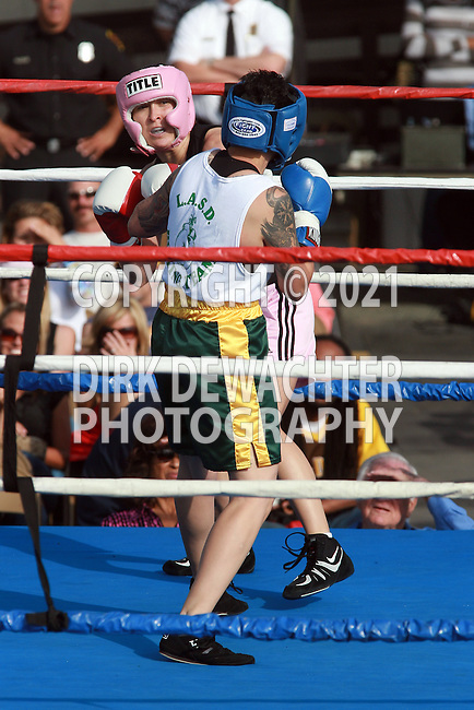 """Whittier, CA 05/10/08 - Evette Almarez of the Los Angeles County Fire Department (in black shirt and pink trunks) boxes against Los Angeles County Sheriff's Department's Mary """"Speedy"""" Vasquez during the LASD boxing event held at the Los Angeles County Sheriff's Academy in Whittier."""