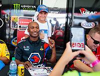 Sep 1, 2018; Clermont, IN, USA; A fan poses for a photo with NHRA top fuel driver Antron Brown during qualifying for the US Nationals at Lucas Oil Raceway. Mandatory Credit: Mark J. Rebilas-USA TODAY Sports