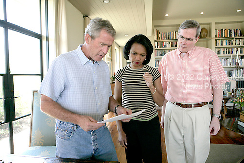 Crawford, TX - August 5, 2006 -- United States President George W. Bush meets with United States Secretary of State Condoleezza Rice and National Security Advisor Steve Hadley at the Bush Ranch in Crawford, Texas to discuss the Middle East, Saturday, August 5, 2006. .Credit: Eric Draper - White House via CNP.