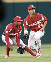 NWA Democrat-Gazette/ANDY SHUPE<br /> Arkansas center fielder Dominic Fletcher (24) fields a ground ball hit by LSU second baseman Brandt Broussard alongside left fielder Christian Franklin Friday, May 10, 2019, during the fourth inning at Baum-Walker Stadium in Fayetteville. Visit nwadg.com/photos to see more photographs from the game.