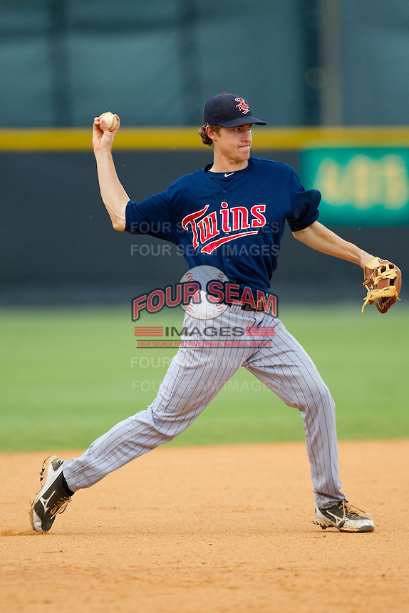 Elizabethton Twins shortstop Ryan Walker (18) makes a throw to first base against the Burlington Royals at Burlington Athletic Park on August 11, 2013 in Burlington, North Carolina.  The Twins defeated the Royals 12-5.  (Brian Westerholt/Four Seam Images)