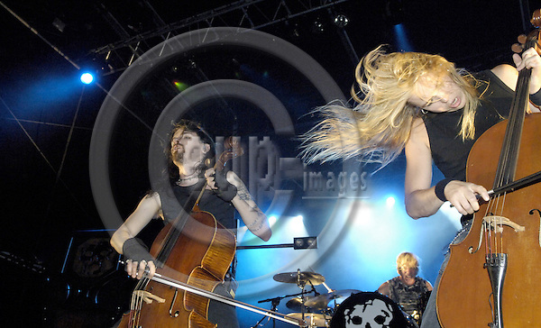 Brussels-Belgium - 01 July 2006---Finnish rock bands MELROSE and APOCALYPTICA set the Grand Place of Brussels under vibrations, to mark the start of the Finnish EU-Presidency; here, Perttu KIVILAASKO (le), Mikko SIRÉN (ce) and Eicca TOPPINEN (ri) of APOCALYPTICA---Photo: Horst Wagner/eup-images