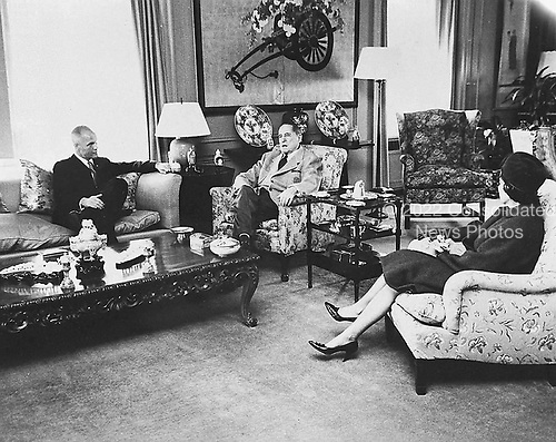 Astronaut John H. Glenn Jr., left, and wife, Annie, right, visit with General Douglas McArthur, center, in the Waldorf Astoria hotel in New York, New York on April 10, 1962..Credit: NASA via CNP