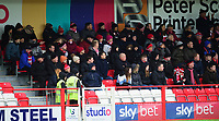Lincoln City fans watch their team in action<br /> <br /> Photographer Andrew Vaughan/CameraSport<br /> <br /> The EFL Sky Bet League One - Accrington Stanley v Lincoln City - Saturday 15th February 2020 - Crown Ground - Accrington<br /> <br /> World Copyright © 2020 CameraSport. All rights reserved. 43 Linden Ave. Countesthorpe. Leicester. England. LE8 5PG - Tel: +44 (0) 116 277 4147 - admin@camerasport.com - www.camerasport.com