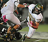 Eddie Munoz #7 of Ward Melville fights for yards after making a catch in the second quarter of a Suffolk County Division I varsity football game against Lindenhurst at Lindenhurst Middle School on Friday, Oct. 7, 2016. Lindenhurst went to halftime leading 16-7.