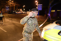 Wednesday 11 January 2017<br /> Pictured: A soldier from the Bomb Squad carries the bomb away from the scene<br /> Re: A World War One bomb which was taken into a Neath Port Talbot pub has been removed and people allowed back home.<br /> South Wales Police evacuated residents in Herbert Street, Pontardawe, at about 19:30 GMT on Wednesday after the device was brought into the Pink Geranium pub before being taken outside.<br /> The Army's ordnance disposal team was called to remove it.<br /> Just after midnight on Thursday, police said the bomb had been taken away and the area declared safe.