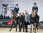 Oi Man Leung of Hong Kong riding Bamako MAurea celebrates winning with Yu An Su of Hong Kong riding Chardonay Hara Des Barrages, equestrian Ludger Beerbaum and Hong Kong Equestrian Federation President Michael Lee at the JETS Challenge during the Longines Masters of Hong Kong at AsiaWorld-Expo on 10 February 2018, in Hong Kong, Hong Kong. Photo by Diego Gonzalez / Power Sport Images