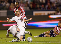 RSL's Nat Borchers pushes a ball away from Chivas USA's Atiba Harris. Real Salt Lake and Chivas USA played to a 2-2 draw in a MLS first round Western Conference playoff match. RSL advances on from aggregate total score at Home Depot Center stadium in Carson, California on Saturday November 8, 2008. Photo by Michael Janosz/isiphotos.com
