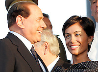 Il Presidente del Consiglio Silvio Berlusconi arriva alla cerimonia per il cambio al vertice dell'Arma dei Carabinieri, a Roma, 23 luglio 2009. A destra, il Ministro delle Pari Opportunita' Mara Carfagna..Italian Premier Silvio Berlusconi arrives for a ceremony to celebrate the installation of the new General Commander of the Carabinieri paramilitary police service in Rome, 23 july 2009. At right, Equal Opportunities Minister Mara Carfagna..UPDATE IMAGES PRESS/Riccardo De Luca