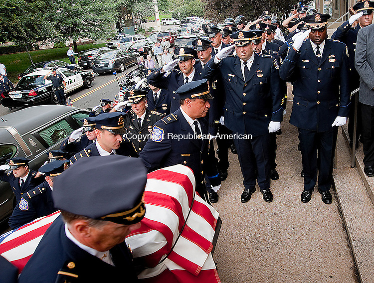 WATERBURY, CT 13 SEPTEMBER 2013--091313JS01-Police officers carry the casket of retired Chief of Police Inspectors  John &quot;Jake&quot; Griffin into Our Lady of Lourdes Church in Waterbury on Friday for a funeral mass. Griffin passed away September 9 at the age of 84.<br /> Jim Shannon Republican American