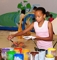Consatia Truitt mixes paint for the mural created as part of the Speak Out Sister program. This is one of the activities at the teen drop-in, weekday evenings at the Wisconsin Youth Company on Madison's west side.