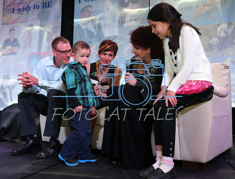 Scott and Kristi Young and their son Isaac, 3, talk with Nevada First Lady Kathleen Sandoval and her daughter Marisa at the Make-A-Wish Waffles & Wishes event at the Atlantis Casino Resort Spa in Reno, Nev., on Tuesday, March 26, 2013..Photo by Cathleen Allison