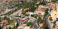 Taormina, panoramic photo of windy roads winding up through Taormina towards Castelmola, Sicily, Italy, Europe. This is a panoramic photo of windy roads winding up through Taormina towards Castelmola, Sicily, Italy, Europe.