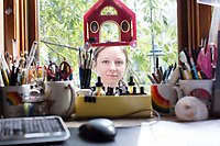 Jada Fitch is an artist and illustrator who lives in Portland, Maine, USA, seen here on Fri., July 28, 2017. She is seen here in the front lawn of her home in Portland. Fitch has recently been making birdhouses that look like living rooms with small portraits of birds. The birdhouses sell out quickly on her Etsy store.