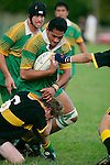M. Peach tries to bring K. Vea to ground.   Counties Manukau Premier Club Rugby, Drury vs Bombay played at the Drury Domain, on the 14th of April 2006. Bombay won 34 - 13.