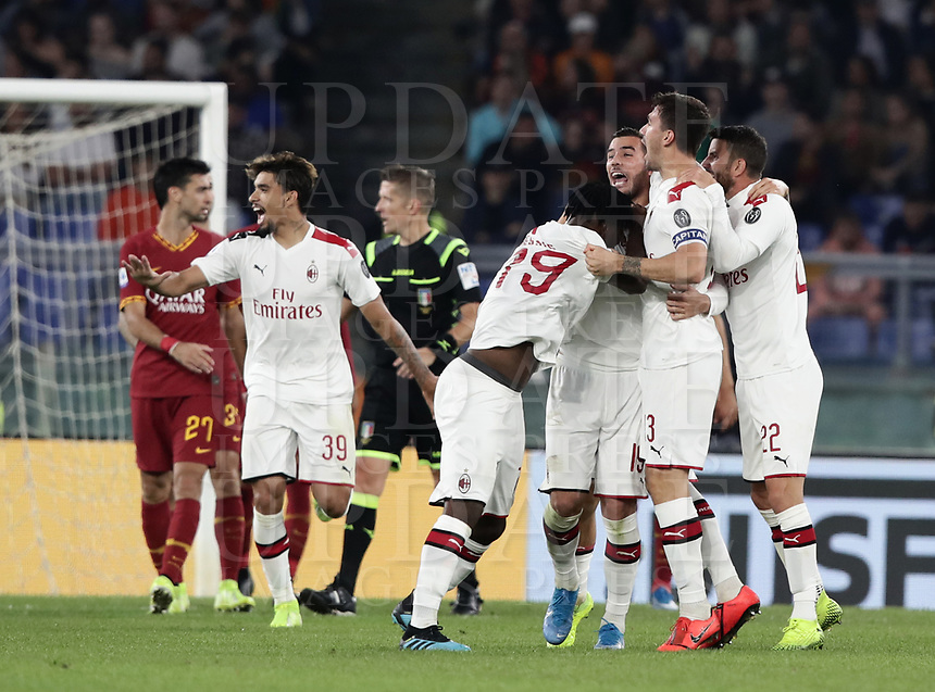 Football, Serie A: AS Roma - AC Milan, Olympic stadium, Rome, October 27, 2019. <br /> Milan's Theo Hernandez (3 from right) celebrates after scoring with his teammates during the Italian Serie A football match between Roma and Milan at Olympic stadium in Rome, on October 27, 2019. <br /> UPDATE IMAGES PRESS/Isabella Bonotto