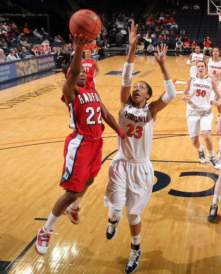 Dec. 6, 2010; Charlottesville, VA, USA; Radford Highlanders guard Da'Naria Erwin-Spencer (22) shoots the ball in front of Virginia Cavaliers guard Ataira Franklin (23) at the John Paul Jones Arena. Virginia won 76-52. Mandatory Credit: Andrew Shurtleff