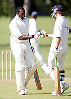 John Scantlebury (L) and R Hall (R) of North London during the Middlesex County League Division three game between North London and South Hampstead at Park Road, Crouch End on Sat July 30, 2011