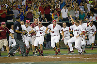 South Carolina's Scott Wingo scores the winning run as his teammates go wild in the 12th inning of Game Two of the NCAA Division One Men's College World Series Finals on June 29th, 2010 at Johnny Rosenblatt Stadium in Omaha, Nebraska.  (Photo by Andrew Woolley / Four Seam Images)