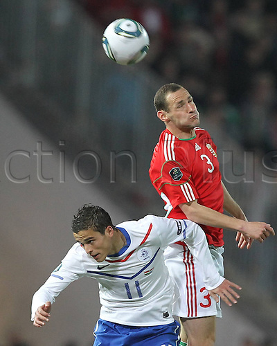 25 03 2011   VilmVanczak Red of Hungary Heads The Ball Over Ibrahim Affelay during The UEFA  Qualifier Game in Budapest between Hungary and The Netherlands men Football National team international match euro Qualif Euro Budapest