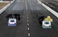 Feb. 21, 2010; Chandler, AZ, USA; NHRA funny car driver Robert Hight (left) defeats teammate Ashley Force Hood during the Arizona Nationals at Firebird International Raceway. Mandatory Credit: Mark J. Rebilas-