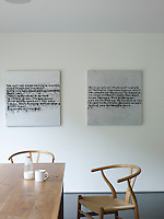 An eclectic collection of art is displayed within the minimal aesthetic of the property