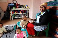 Feeding the kids in a creche in Khayelitsha, Cape Town, SA 2010