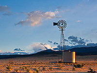 The sun sets on a lone windmill outside of Carrizozo, New Mexico