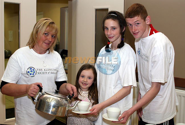 Doloris, Leah and Ciara Maguire with Brian O'Connor at St Peters Church of Ireland Bring and Buy Sale in aid of The Alzheimers Society...Photo NEWSFILE/Jenny Matthews.(Photo credit should read Jenny Matthews/NEWSFILE)....This Picture has been sent you under the condtions enclosed by:.Newsfile Ltd..The Studio,.Millmount Abbey,.Drogheda,.Co Meath..Ireland..Tel: +353(0)41-9871240.Fax: +353(0)41-9871260.GSM: +353(0)86-2500958.email: pictures@newsfile.ie.www.newsfile.ie.FTP: 193.120.102.198.