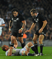 Ma'a Nonu and Conrad Smith (right) check on England captain Chris Robshaw during the international rugby match between the New Zealand All Blacks and England at Eden Park, Auckland, New Zealand on Saturday, 7 June 2014. Photo: Dave Lintott / lintottphoto.co.nz
