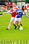 Kerins O'Reilly Gearoid Savage in possession of the ball closely watched by Daingean Uí Chúis Gavan Ó Corráin and Dara Ó Súilleabháin during the County League Div.1 match at Páirc an Ághasaigh, Dingle, on Sunday afternoon.