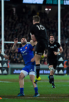 NZ's Jordie Barrett takes a high kick as France's Fabien Sanconnie waits during the Steinlager Series international rugby match between the New Zealand All Blacks and France at Eden Park in Auckland, New Zealand on Saturday, 9 June 2018. Photo: Dave Lintott / lintottphoto.co.nz