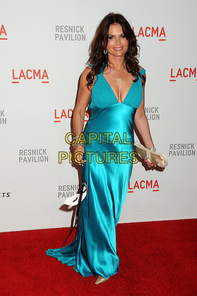 "ROMA DOWNEY .LACMA's ""The Unmasking"" of the Lynda & Stewart Resnick Exhibition Pavilion Opening Gala held at the Los Angeles County Museum of Art, - Los Angeles, California, USA, 25th September 2010..full length blue turquoise dress long maxi mask cleavage clutch bag  .CAP/ADM/BP.©Byron Purvis/AdMedia/Capital Pictures."