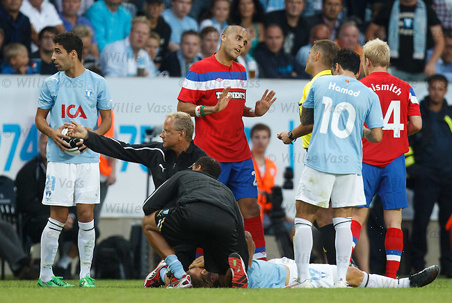 Madjid Bougherra protests his innocence to the referee after being shown a red card
