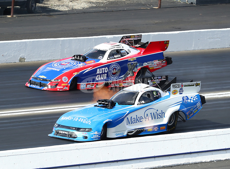 Feb 9, 2019; Pomona, CA, USA; NHRA funny car driver Tommy Johnson Jr (near) races alongside Robert Hight during qualifying for the Winternationals at Auto Club Raceway at Pomona. Mandatory Credit: Mark J. Rebilas-USA TODAY Sports