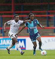 Marcus Bean of Wycombe Wanderers & Manny Oyeleke of Aldershot Town during the pre season friendly match between Aldershot Town and Wycombe Wanderers at the EBB Stadium, Aldershot, England on 22 July 2017. Photo by Andy Rowland.