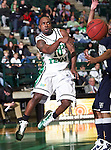 North Texas Mean Green guard Josh White (10) passes the ball under the basket in the game between the Jackson State Tigers and the University of North Texas Mean Green at the North Texas Coliseum,the Super Pit, in Denton, Texas. UNT defeated Jackson 68 to 49